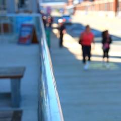 Promenade (halifaxlight) Tags: street urban canada blur walking square downtown novascotia shadows bokeh sunny pedestrians railing halifax