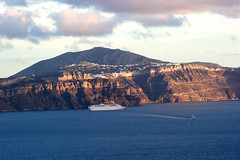 The magic of light (Nagarjun) Tags: blue sunset sun white church island volcano evening europe glow santorini caldera oia cyclades mediterranian firostefani aegeansea