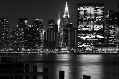 The United Nations building (Lojones13) Tags: blackandwhite newyork night cityscape chryslerbuilding unitednationsbuilding