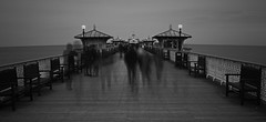 Ghostly encounters on Llandudno pier. (foto.pro) Tags: sea people bw wales pier dusk welsh ghostly llandudno