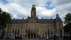 City Hall (Michel Curi) Tags: rotterdam netherlands holland nederland centrum dutch europe grotemarkt buildings edificios structures estructuras arquitectura architecture historic beauxart byzantine roman artdeco cityhall government sky clouds clock flags