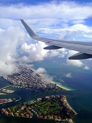 Leaving Miami  with a South Beach view (Yalila Guiselle) Tags: airplane plane view south beach miami skyclouds southbeach clouds window