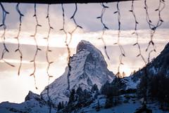 Matterhorn series - Through the window (redgoldish) Tags: throughwindow matterhorn zermatt switzerland mountain snow backlight clouds travel landscape