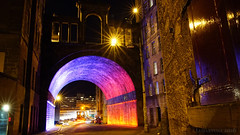 the lure of a nightly city (lunaryuna) Tags: scotland capital edinburgh urban city citylight architecture urbanconstructs nightlights nightphotography nocturnalphotography bridge illumination arches walkinthecity colours buildings beauty urbanlandscape le longexposure lunaryuna