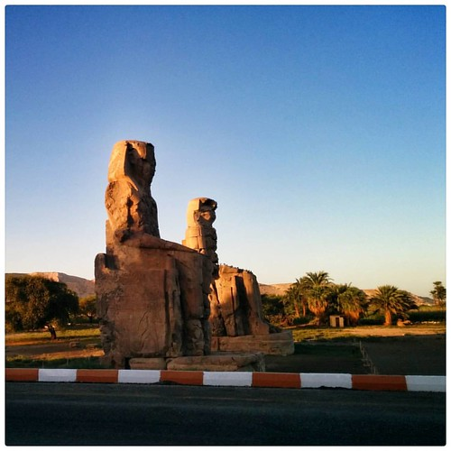 #egypt #luxor #memnon #guardiantravelsnaps  Sunset over the the Memnon Colossus.