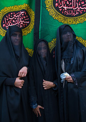 Portrait of iranian shiite muslim women with their faces hidden by a veil mourning imam hussein on tasua during the chehel manbar ceremony one day before ashura, Lorestan province, Khorramabad, Iran (Eric Lafforgue) Tags: 3people adultsonly ashura calligraphy ceremony chador clothing colorimage covered hidden hussain imamhussein iran islam khorramabad lookingatcamera memorialevent middleeast mourner mourning muharram muslim mysterious mystery niqab outdoors people persia religion religious ritual script shia shiism shiite sugar tasoua tasua threepeople veil veiled vertical waistup women womenonly lorestanprovince ir