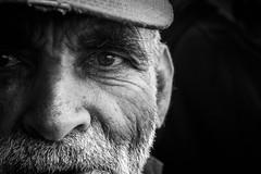 Sad eyes (Vitor Pina) Tags: street portrait people blackandwhite monochrome eyes face man portraits