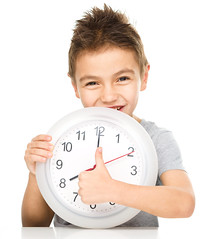 Boy is holding big clock (mommymundoxyz) Tags: holding gesturing showing morning schedule early friendly optimistic successful cheerful smiling time caucasian brunette male boy child kid people one person vertical isolated clock get up eight awake alert gesture thumb smile happy cutout childhood cute human last minute young alarm wake sign cool success symbol winner yes