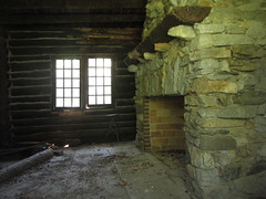 58. Through the Window (Foxy Belle) Tags: old windows mountain abandoned stone log cabin fireplace antique interior rustic inside pane adirondack primitive shabby
