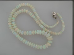 Ethopian opal strand 23 inch 14kt wg w dia