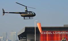 G-FRYA Robinson R44 (4) @ Excel London 03-10-15 (AJBC_1) Tags: uk england london unitedkingdom helicopter docklands excel eastlondon silvertown nikond3200 newham royaldocks excelexhibitioncentre londonboroughofnewham londonexcelcentre robinsonr44ravenii dlrblog londonsroyaldocks ajc gfrya helitech2015 helitech15 a2baerolimited