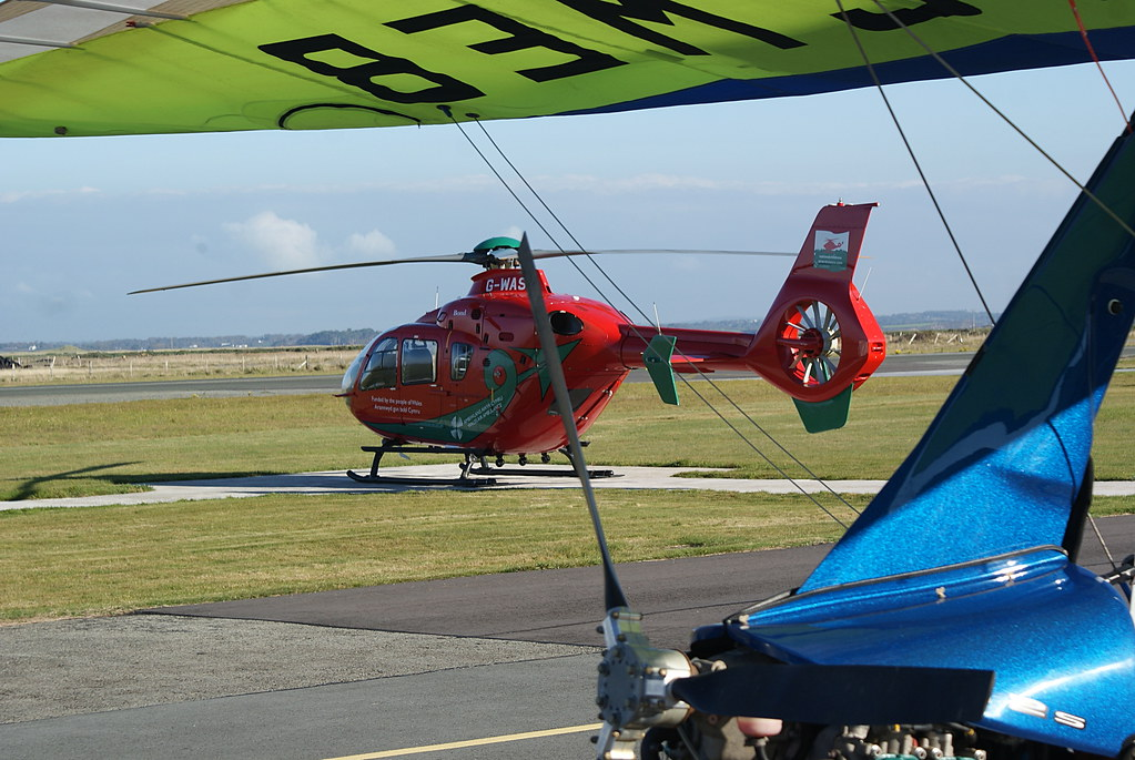 Colourful Wales Air Ambulance poised for action beside us
