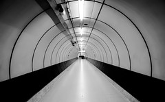 Happiness is Halfway From Here to There (TS446Photo) Tags: nikon lul ts446 d600 underground london londonunderground tube train station architecture tunnel metro black white bw mono monochrome blackandwhite long exposure format hitech 16stop nikkor le longexposure tripod d800 df fx city cityscape landscape urban detail contrast sharp lightroom manfrotto befree explore flickr fineart art fine print forsale sold sale street photographer londonfineartphotography photography tint dslr pro wow unique iconic icon legend england uk britain europe