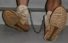 When vintage meets vintage (asiancuffs) Tags: handcuffs handcuffed shackled shackles sneakers reebok