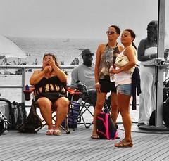 """All the single ladies"" (Lidiya Nela) Tags: womenofnewyork women urban candid brooklyn city ladies boardwalk beach summer newyorkcity newyork nyc streetphotography people coneyisland partialcolor selectivecolor"