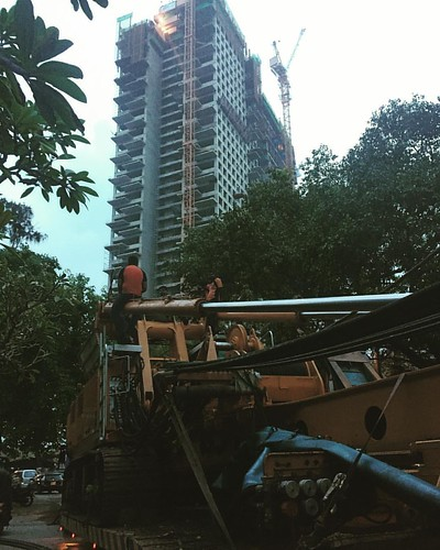 """Waiting for the #night #shift""....  In the shadows of one of the latest and biggest #urbandevelopment projects of #colombo, workers wait with their toy ready to start the assault on a #building  that the closest that they will ever get to is the fact tha"