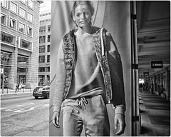 Streetwear (Steve Lundqvist) Tags: model streetwear street streetphotography jacket berlin germany advertising publicita cartellone woman bw blackandwhite monochrome nikon 24mm sidewalk dof fashion moda look sportwear sporty girl