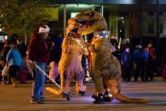 The Curling Dinos Prepare for Battle (LostOne1000) Tags: cedarrapids fireandice winter curling cold iowa parade christmas downtown dinosaurs unitedstates us holidaydelightparade