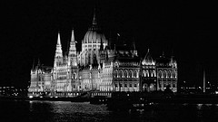 Hungary Parliament (oxfordblues84) Tags: travel blackandwhite bw reflection building water architecture night reflections river evening europe hungary nightlights budapest parliament dome danube afterdark danuberiver orszghz gothicrevival vikingrivercruise 5photosaday imresteindl hungaryparliament hungaryparliamentbuilding