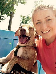 Chelsea enjoys supporting the Humane Society by spending time with the dogs.