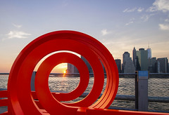 Spiralling light (Olivier So) Tags: nyc sunset sky usa ny newyork water brooklyn manhattan eastriver jeppehein modifiedsocialbenches