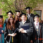 Students and professor at commencement.