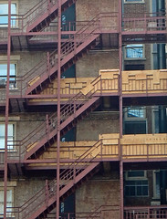 Fire escape (TheMachineStops) Tags: outdoor nyc newyorkcity manhattan uws upperwestside fireescape brick wood 2016 steps building