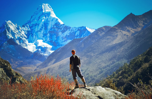 Man hiking on a stone view in the himalayas, Ama Dablam ,Nepal