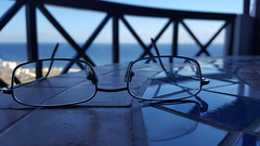Looking to the Sea (joe-so) Tags: brille meer meerblick strand glasses sea beach blue water tiefenschrfe tisch tal table zoomin valley
