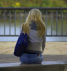 The View (swong95765) Tags: blonde woman female lady purse seated jeans river walkway solitary