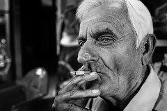 The pleasure (Giulio Magnifico) Tags: powerful soulful blackwhite bw streetphotography reportage gaze thread smoke 28mm italy morning watching look intense pleasure smoker sigarette portrait leicaq leica salerno