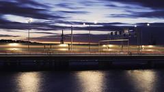 Train Blur (Origin_AL) Tags: stockholm sweden europe nikon train travel bridge water light reflections sky night evening colour retro neon blur slowshutterspeed clouds lighttrails