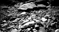 Pebbledash (http://richard-m.myportfolio.com/) Tags: blackandwhite beach landscape fuji stones pebbles bnw lightroom xe1 fujix 18f2