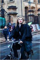 Oxford Girl (MatthewsCamera) Tags: cyclist girl gown graduate oxford university oxforduniversity female moody redlipstick prime canon streetphotography street british winter f14 50mm powerful