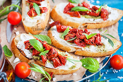 Bruschetta with cream cheese, pesto, fresh basil and sun dried t (Katty-S) Tags: appetizer slice board bread bruschetta goat cream cheese blue dinner food italian tomato basil pesto lunch sun dried preserve relish rustic salad sandwich snack wooden herb vegetable crostini toast baguette ciabatta