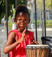 Will Trump be kind to me? (ybiberman) Tags: israel jerusalem girl african immigrant drum drummer portrait candid streetphotography worry anxiety beggar