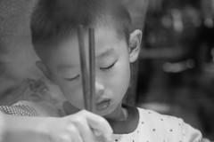 Eating Sichuan Hot Pot (Robert Borden) Tags: people child boy innocent portrait asia china sichuanprovince chengdu hotpot steam dinner opera chopsticks bw indoors