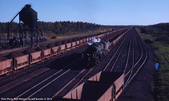 LATE DAY view of the Great Northern Railway at Kelly Lake, Minnesota 1953 (Twin Ports Rail History) Tags: twin ports rail history by jeff lemke time machine kelly lake minnesota 1953 class n3 2880 steam locomotive mesabi iron ore train power railway railroad mallet articulated baldwin works range division ogle steel coaling tower cars fuel oil tank