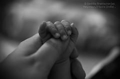 A mom's Love (Sanhita Bhattacharjee) Tags: sanhitabhattacharjee tripura india blackandwhite 121click photography nikkor50mm18g nikkor35mm nikond7000 nikkor daughter childphotography children bond mother child betterphotography blur closeup indoor hands