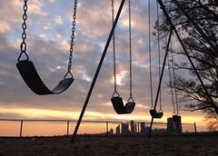 sunset swing (Mr.  Mark) Tags: swing sunset silhouette toronto skyline city cloud playground nostalgia stock photo markboucher