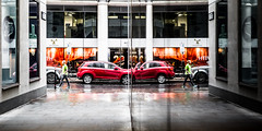 Collision Course (Sean Batten) Tags: reflection window glass red london england unitedkingdom gb green car people alley streetphotography street city urban nikon df 50mm
