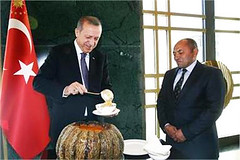 Turkish President Recep Tayyip Erdogan prepares to offer an Ashura meal to a head of village at his palace (legend_news) Tags: village head president palace an offer meal his ashura ankara turkish prepares erdogan recep tayyip
