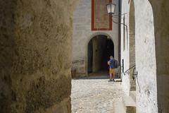In the corner (Michal Soukup) Tags: light people salzburg corner person austria shadows path walls hohensalzburg nikond600 nikkor35mmf18g