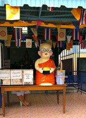 """""""Please, sir, I want some more."""" (John 3000) Tags: travel cute thailand glasses asia bangkok statues monk monks lil streetscenes alms 2015"""