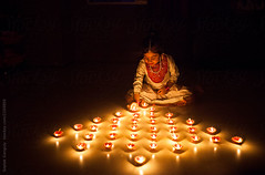 ... (Saptak Ganguly) Tags: bengali celebration child childhood culture decorating decoration deepavali diwali earthenlamps festival festive happy indianethnicity kurti light littlegirl night oillamp saree sit traditional traditionaldress traditionalfestival