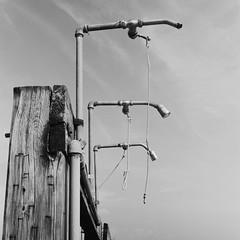 Beach Showers (Dalliance with Light (Andy Farmer)) Tags: oceangrove showerheads beach asburypark rodinal nj acros hasselblad500c film shore neptunetownship newjersey unitedstates us dslrscan