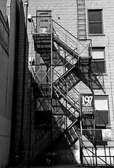 197 Shadows (armykat) Tags: torontoontariocanada springshenanigansintoronto monochrome blackandwhite stairs stairway stairwell steps fireescape