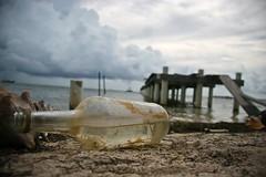 message in a bottle (CartOrange Suisse) Tags: belize cayecaulker messageinabottle mattina pontile conchiglia sabbia nuvole paradiso