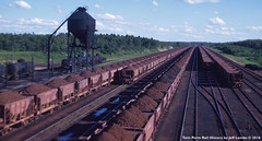 AFTERNOON view of the Great Northern Railway at Kelly Lake, Minnesota 1953 (Twin Ports Rail History) Tags: twin ports rail history by jeff lemke time machine kelly lake minnesota 1953 mesabi iron ore train railway railroad range division ogle steel coaling tower cars fuel oil tank
