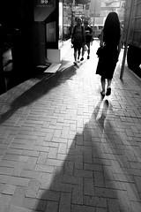 Unnamed long shadow (Job Homeless) Tags: people hongkong x10 fujifilm streetsnap streetphotography blackandwhite monochorme urban city